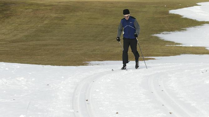 Tom Cwick, of Los Angeles, cross country skis on machine-made snow at the Weston Ski Track in Weston, Mass., Wednesday, Feb. 6, 2013.  A midwinter storm headed to the Northeast on Friday could drop more than a foot of snow. (AP Photo/Charles Krupa)