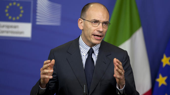 OECD urges Italy to keep austerity as Rome balks