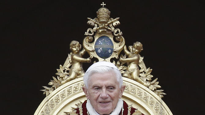 """Pope Benedict XVI delivers his """"Urbi et Orbi"""" (to the City and to the World) speech from the central loggia of St. Peter's Basilica, at the Vatican, Tuesday, Dec. 25, 2012. Pope Benedict XVI has wished Christmas peace to the world, decrying the slaughter of the """"defenseless"""" in Syria and urging Israelis and Palestinians to find the courage to negotiate. Delivering the Vatican's traditional Christmas day message from the central balcony of St. Peter's Basilica, a weary-looking and hoarse-sounding Benedict on Tuesday also encouraged Arab spring nations, especially Egypt, to build just and respectful societies. (AP Photo/Gregorio Borgia)"""