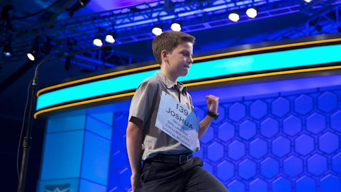 "Joshua Sturgill of Sedalia, Mo., pumps his fist after getting the word ""aggrandizement"" correct during the third round of the National Spelling Bee, Wednesday, May 29, 2013, in Oxon Hill, Md. (AP Photo/Evan Vucci)"