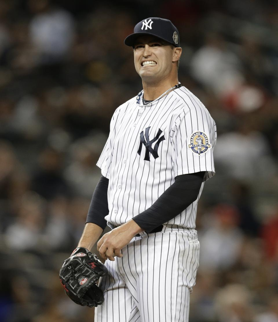 New York Yankees relief pitcher David Huff reacts after allowing a sixth-inning, three-run home run to Tampa Bay Rays' Evan Longoria in a baseball game Wednesday, Sept. 25, 2013, in New York. (AP Photo/Kathy Willens)