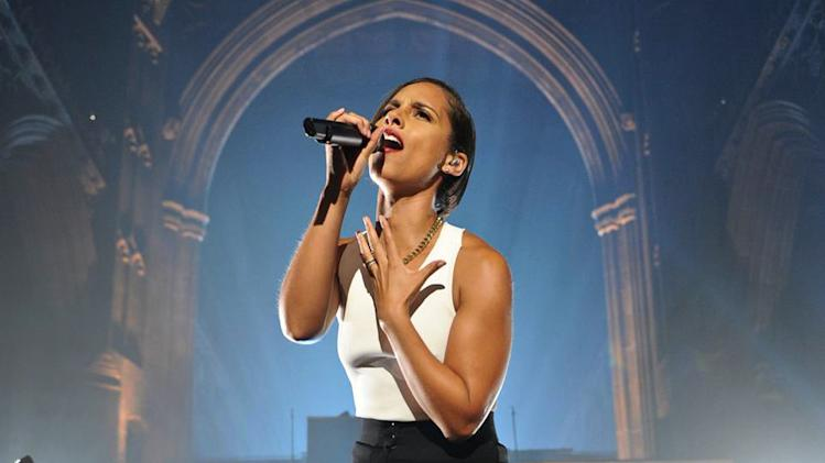 """FILE - This Sept. 24, 2012 image released by MTV Crashes Manchester shows Alicia Keys headlining """"MTV Crashes Manchester"""" in the city's cathedral, Manchester, England.  Keys and Dionne Warwick are known for singing pop and R&B, but they'll be honored as black women who """"rock"""" on BET. The """"Black Girls Rock!"""" special, which honors the accomplishments of black women, returns to the network on Nov. 4; the actual ceremony will be held Oct. 13 in the Bronx, N.Y., with actresses Tracee Ellis Ross and Regina King returning as hosts. (AP Photo/Andrew Timms/MTV Crashes Manchester)"""