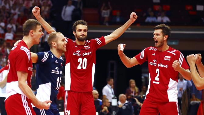 Poland's team celebrate a point during their semifinal match against Germany at the FIVB Volleyball Men's World Championship Poland 2014 at Spodek Arena in Katowice