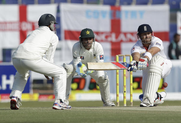 England's Matt Prior, right, hits the ball watched by Pakistan's Adnan Akmal, center, during the third day of the second cricket test match of a three match series between England and Pakistan at Zaye