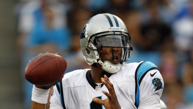 Carolina Panthers quarterback Cam Newton (1) passes against the Houston Texans during the first half of an NFL preseason football game in Charlotte, N.C., Saturday, Aug. 11, 2012. (AP Photo/Bob Leverone)