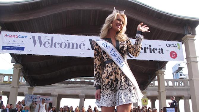 In this Sept. 3, 2014 photo, Miss Virginia Courtney Garrett wqves during a welcoming ceremony for the Miss America contestants in Atlantic City N.J. The next Miss America will be crowned Sunday Sept. 14.(AP Photo/Wayne Parry)