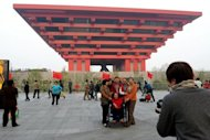 This file photo shows visitors taking pictures in front of China&#39;s pavilion at the site of the World Expo in Shanghai, in 2010. Shanghai on Monday opened two new art museums on the former site of the 2010 World Expo, as China&#39;s commercial hub seeks to rival art capitals like New York and Paris