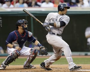 New York Yankees' Robinson Cano watches his two-run double off Cleveland Indians starting pitcher Carlos Carrasco in the second inning of a baseball game, Tuesday, April 9, 2013, in Cleveland. Indians catcher Yan Gomes is at left. (AP Photo/Tony Dejak)