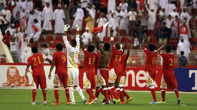 Omani players celebrate after defeating Iraq 1-0 during their group B Asian zone qualifying football match for the 2014 World Cup in Muscat (AFP)