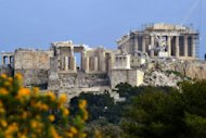 Tourists visit the ancient Acropolis hill in Athens in March 2012. Europeans are avoiding vacations to Greece this summer fearing instability sparked by the debt crisis, industry sources say, inflicting a hard blow to the country's already devastated economy