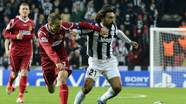 Juventus' Italian midfielder Andrea Pirlo vies for the ball with Nordsjaelland's Danish midfielder and team captain Nicolai Stokholm during the UEFA Champions League Group E football match FC Nordsjaelland