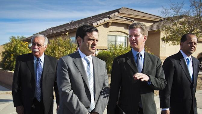 U.S. Rep. Ed Pastor , left, Phoenix Mayor Phil Gordon, HUD Secretary Shaun Donovan  and Chicanos por la Causa Pres. Edmundo Hidalgo   walk toward a house in a federal Neighborhood Stabilization Program  area in the South Mountain  area of Phoenix  on Thursday, Nov.  10, 2011 . The Program provides funding for cities and states to work with nonprofit housing agencies to acquire, rehabilitate and sell or rent houses that have been foreclosed, vacant and abandoned.   (AP Photo/The Arizona Republic, Charlie Leight)
