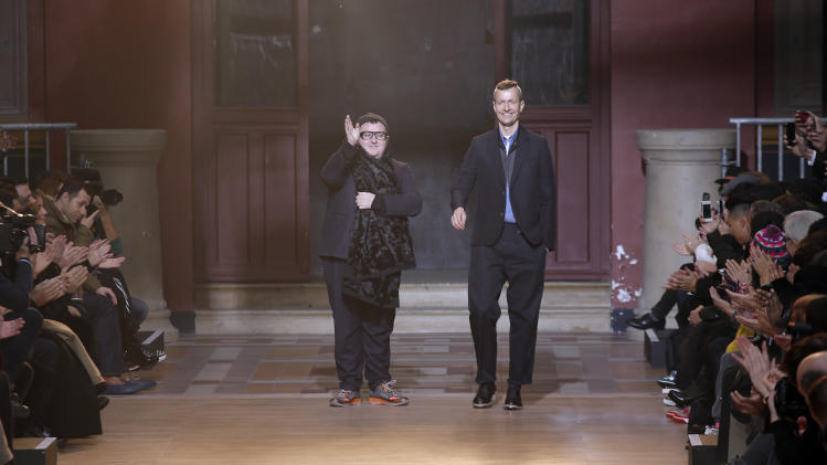 The Netherlands fashion designer Lucas Ossendrijver, right, and creative director Alber Elbaz, cheers the audience after the presentation of Lanvin fall-winter 2013/2014 men's fashion collection, presented in Paris, Sunday, Jan.20, 2013. (AP Photo/Christophe Ena)