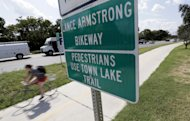 A cyclist rides along the Lance Armstrong Bikeway, Friday, Aug. 24, 2012, in Austin, Texas. The U.S. Anti-Doping Agency stripped Armstrong&#39;s seven Tour de France titles Friday, erasing one of the most incredible achievements in sports after deciding he had used performance-enhancing drugs to do it. (AP Photo/Eric Gay)