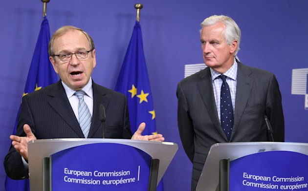 European Commissioner for Internal Market and Services Michel Barnier, right, and Erkki Liikanen, Member of the Governing Council of the European Central Bank and Chairman of the High-level Expert Group, address the media on possible reforms to the structure of the EU banking sector, at the European Commission headquarters in Brussels, Tuesday, Oct. 2, 2012. (AP Photo/Yves Logghe)