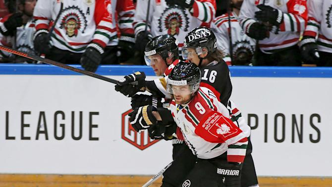 Larsson and Abbott of Frolunda Indians challenge Aho of Oulun Karpat during the CHL final match in Oulu
