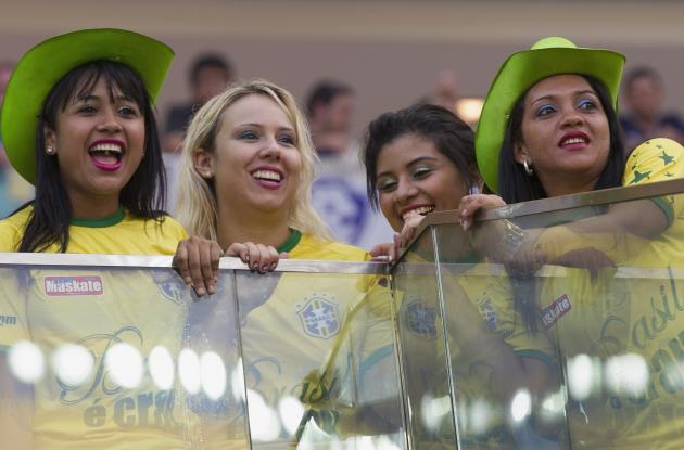 Fans watch the inauguration of the Arena Amazonia Vivaldo Lima soccer stadium in Manaus