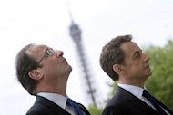 France&#39;s outgoing president Nicolas Sarkozy (R) and president-elect Francois Hollande (L) take part in a ceremony marking the 67th anniversary of the Allied victory over Nazi Germany in World War II, at the Arc de Triomphe in Paris. Hollande&#39;s first foreign trip as president will be to Berlin next week