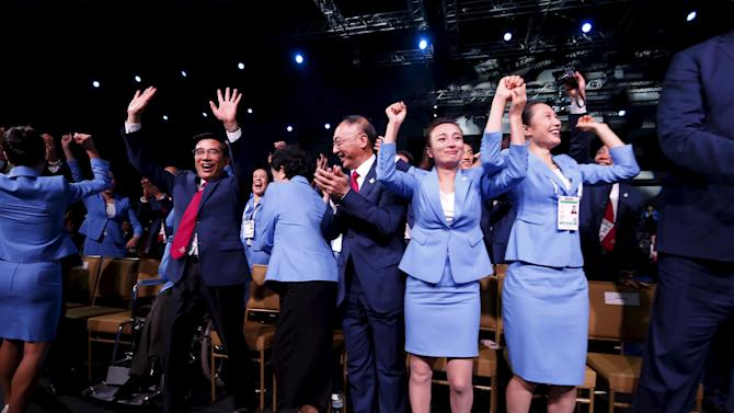 Members of the delegation from Beijing 2022 Winter Olympics candidate city reacts after the city was elected to host the 2022 Olympic Winter Games at IOC meeting in Kuala Lumpur