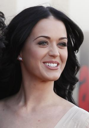 """FILE - In this April 19, 2011 file photo, singer Katy Perry arrives for the European premiere of """"Arthur"""" at the O2 Arena in London. Perry leads the MTV Video Music Award nominations with nine, including video of the year for her song """"Firework."""" (AP Photos/ Joel Ryan, File)"""
