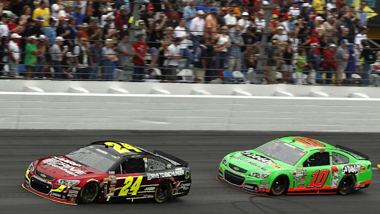Jeff Gordon (24) and Danica Patrick (10) lead during early laps of the NASCAR Daytona 500 Sprint Cup Series auto race at Daytona International Speedway, Sunday, Feb. 24, 2013, in Daytona Beach, Fla. (AP Photo/Terry Renna)