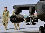 <p>Britain's Prince Harry (L) is shown an Apache helicopter upon his arrival at Camp Bastion in Afghanistan, on September 7. Harry was moved under guard to a secure location during a Taliban attack on the camp last Friday, the base where he is deployed in Afghanistan, according to Britain's defence minister.</p>