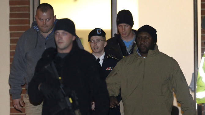 Army Pfc. Bradley Manning, center, is escorted out of a courthouse in Fort Meade, Md., Tuesday, Nov. 27, 2012, after attending a pretrial hearing. Manning is charged with aiding the enemy by causing hundreds of thousands of classified documents to be published on the secret-sharing website WikiLeaks. (AP Photo/Patrick Semansky)