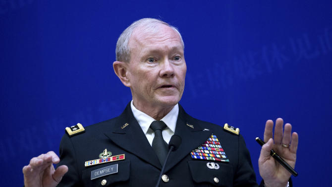 U.S. Joint Chiefs Chairman Gen. Martin Dempsey speaks during a press briefing with Chinese counterpart Gen. Fang Fenghui at the Bayi Building in Beijing, China Monday, April 22. 2013. (AP Photo/Andy Wong, Pool)