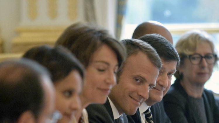 Newly-named French Economy Minister Emmanuel Macron attends the first weekly cabinet meeting after a government reshuffle at the Elysee Palace in Paris