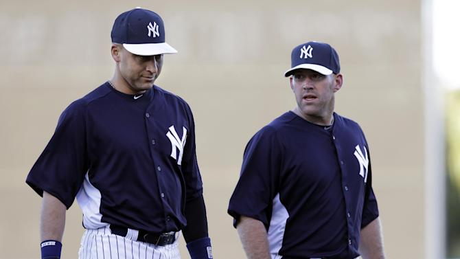 FILE - In this March 13, 2013, file photo, New York Yankees shortstop Derek Jeter, left, and third baseman Kevin Youkilis talk before a spring training baseball game in Tampa, Fla. The Yankees said Thursday, April 18, 2013, that Jeter will be sidelined until after the All-Star break because of a new fracture in his injured left ankle.  (AP Photo/Kathy Willens, File)