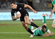 New Zealand&#39;s Sonny Bill Williams (L) breaks the tackle of Cian Healy of Ireland during their rugby union match at Eden Park in Auckland, on June 9. Williams said on Monday he was quitting the world champion All Blacks to take up a club contract in Japan, then return to rugby league in Australia