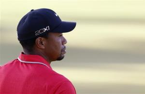 Tiger Woods of U.S. leaves the course after finishing the final round of the inaugural Turkish Airlines Open in the south west city of Antalya