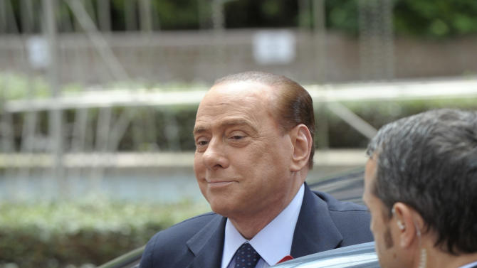 Italy's Prime Minister Silvio Berlusconi arrives for an EU summit of eurogroup members at the EU Council building in Brussels on Thursday, July 21, 2011. Eurozone leaders are moving closer to signing off on a second bailout for Greece but markets are fretting that any deal that emerges later Thursday may imply a Greek debt default after a plan to slap a tax on banks appears to have been shelved. (AP Photo/Geert Vanden Wijngaert)