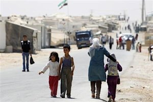 Syrian refugees children walk at Al-Zaatri refugee …
