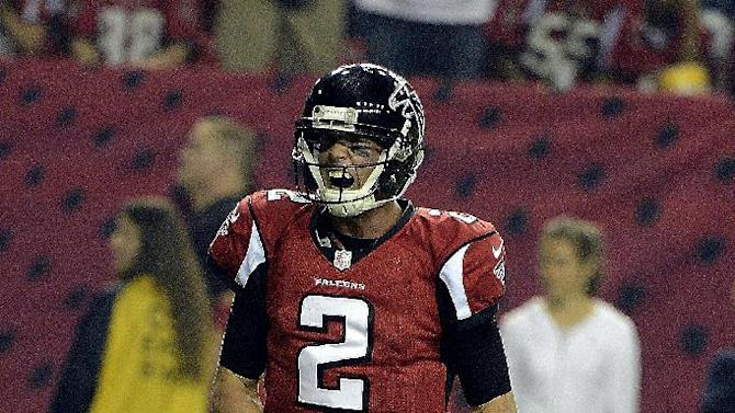 Atlanta Falcons quarterback Matt Ryan (2) reacts after a touchdown run by Michael Turner during the second half of an NFL football game against the Dallas Cowboys, Sunday, Nov. 4, 2012, in Atlanta. (AP Photo/Rich Addicks)