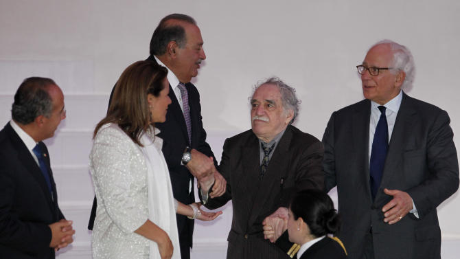 From left to right, Mexico's President Felipe Calderon, his wife Margarita Zavala, Mexico's businessman Carlos Slim, Nobel Prize laureate Gabriel Garcia Marquez and British financier Sir Evelyn de Rothschild attend the inauguration of the Soumaya Museum's new home in Mexico City, Tuesday March 1, 2011. The new building which will open to the general public on March 29, will house Mexican billionaire Slim's fast-growing art collection. (AP Photo/Eduardo Verdugo)
