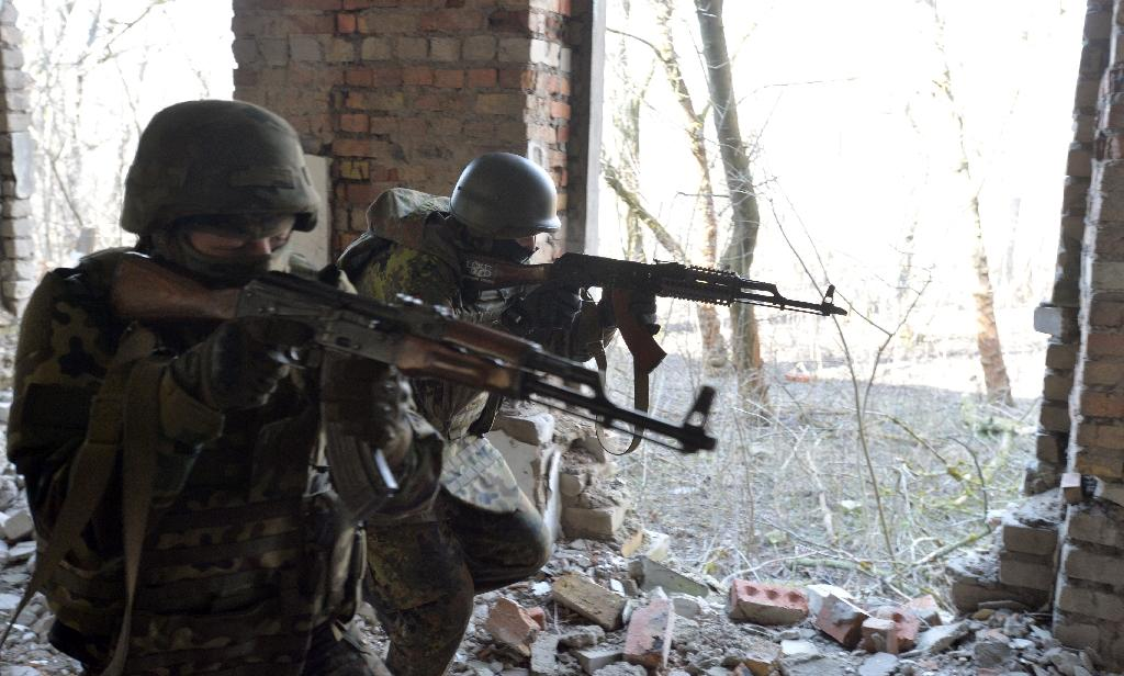 Two killed as clashes threaten fragile Ukraine truce