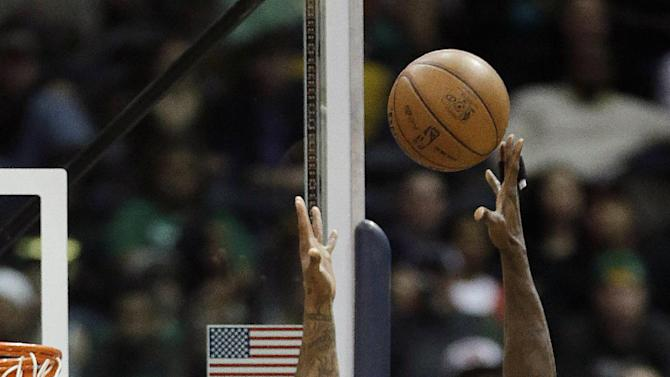 Boston Celtics forward Kevin Garnett, right, shoots over Atlanta Hawks forward Josh Smith during the first half of an NBA basketball game Friday, Jan. 25, 2013, in Atlanta. (AP Photo/John Bazemore)