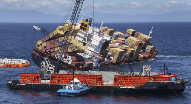 FILE - In this Nov. 14, 2011 file image released by New Zealand Maritime, a sea crane, foreground, is in place to begin removing some of the 1,280 containers that remain on board the cargo ship Rena,