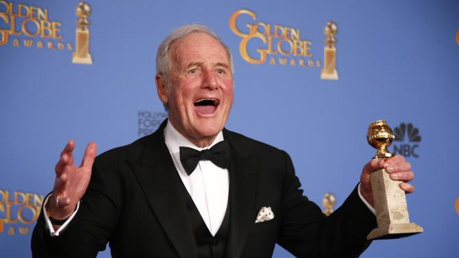 """File photo of producer Jerry Weintraub posing backstage with the award for Best TV Movie or Mini-Series for """"Behind the Candelabra"""" at the 71st annual Golden Globe Awards in Beverly Hills"""