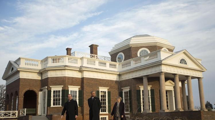 President Barack Obama, center, and French President Francois Hollande, left, tour the grounds of Monticello, President Thomas Jefferson's estate, Monday, Feb. 10, 2014, in Charlottesville, Va. Leading the tour is Leslie Bowman, right, president of the Thomas Jefferson Foundation. (AP Photo/Pablo Martinez Monsivais)
