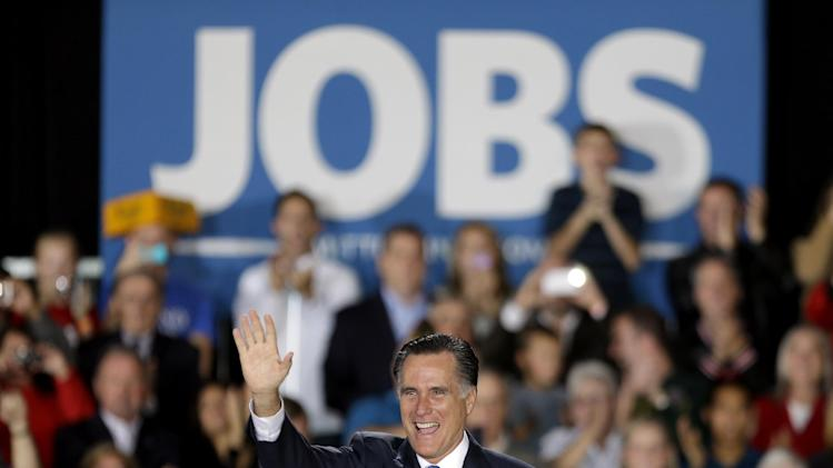 Republican presidential candidate, former Massachusetts Gov. Mitt Romney waves to supporters before speaking during a campaign event at Wisconsin Products Pavilion at State Fair Park, Friday, Nov. 2, 2012, in West Allis, Wis. (AP Photo/David Goldman)