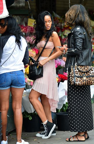 One of the many, many things Rihanna will one day realize she and I have in common is a love of skirts and dresses with sneakers. In NYC's SoHo, she struck a pose on an oppressively hot June 11 in a p