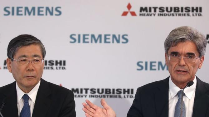 President and Chief Executive Officer of Siemens Kaeser and Mitsubishi Heavy Industries Chief Executive Miyanaga attend a news conference after a meeting with French government in Paris