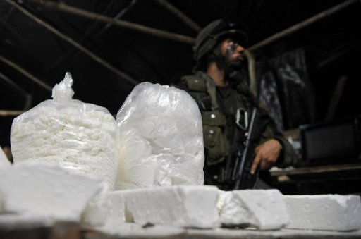 <p>This file photo shows Colombian police personnel from an anti-narcotics unit, with cocaine seized from an illegal laboratory, in 2011. A semi-submersible ship, ready to be loaded with six tons of cocaine, was seized by Colombian military near the northern coast of the South American nation, the Navy reported Monday.</p>