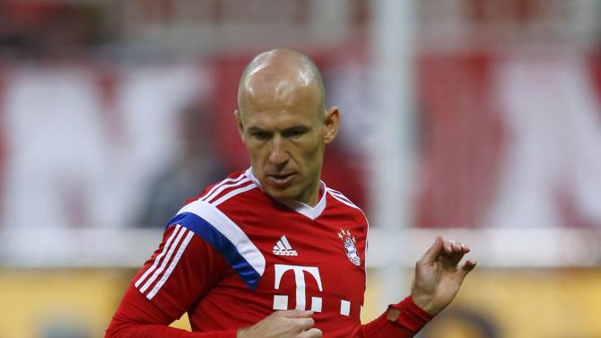 Bayern Munich's Robben warms-up prior to German Cup semi-final soccer match against Borussia Dortmund in Munich