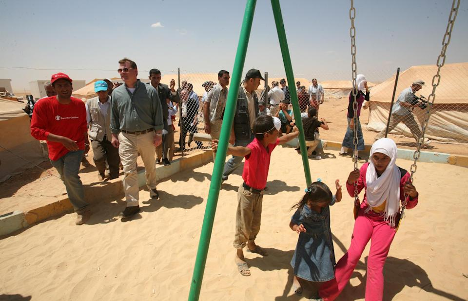 Canadian Foreign Affairs Minister John Baird, second left,  visits Zaatari camp for Syrian refugees,  in Mafraq, Jordan, Saturday, Aug. 11, 2012.  (AP photo/Mohammad Hannon)