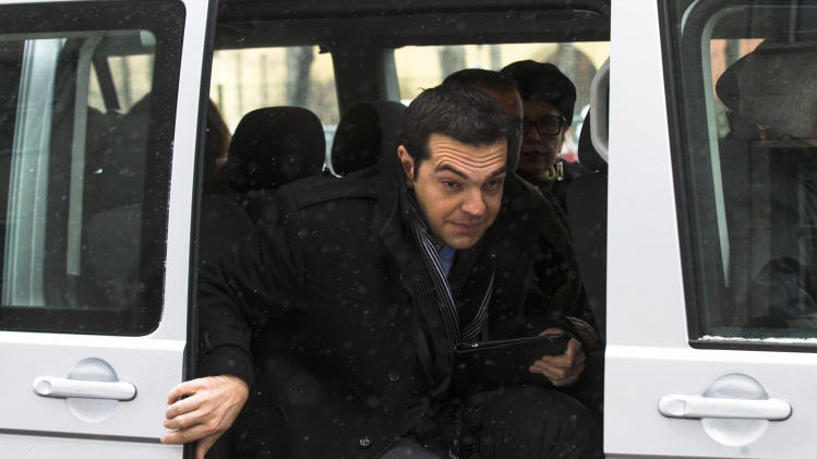 Greek left wing politician and party leader Alexis Tsipras opens the car door as he arrives at the German Finance Ministry for a closed meeting with Finance Minister Wolfgang Schaeuble in Berlin, Monday, Jan. 14, 2013. (AP Photo/Markus Schreiber)