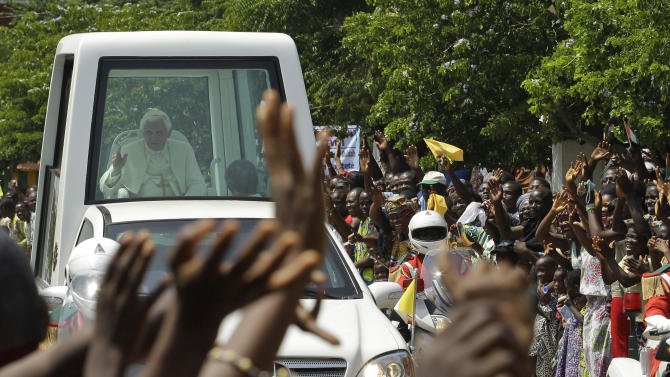 Pope Benedict XVI waves to Catholic faithful as he arrives at the basilica in Ouidah, Benin Saturday, Nov. 19, 2011. Pope Benedict XVI on Saturday called on Africa's leaders to stop depriving their people of hope and to govern responsibly, just hours before he planned to unveil a pastoral guide for the continent which attempts to use church doctrine to address Africa's problems.(AP Photo/Rebecca Blackwell)