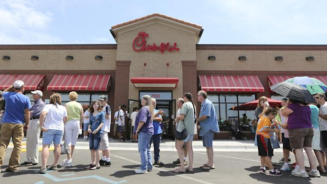 FILE - In a Wednesday. Aug. 1, 2012 file photo, customers stand in line for a Chick-fil-a meal at the chain's restaurant in Wichita, Kan. The crowd was buying meals to show their support for the company that's currently embroiled in a controversy over same-sex marriage. On this and so many other issues this election year, it seems harder to find that middle-ground gray when our debates seem so very black or white.  (AP Photo/The Wichita Eagle, Travis Heying, File) LCOAL TV OUT; MAGS OUT; LOCAL RADIO OUT; LOCAL INTERNET OUT